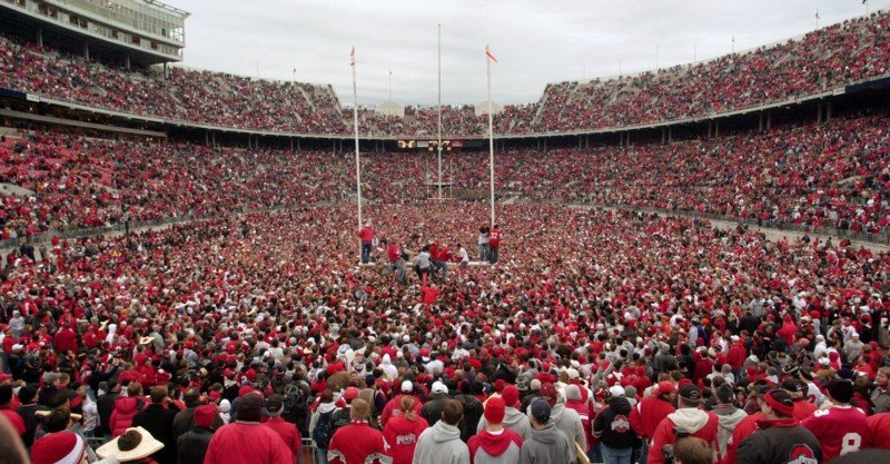 Fans rush the field at Ohio Stadium following a 14-9 OSU victory against Michigan on Nov. 23, 2002. Credit: Courtesy of John Kuntz / The Plain Dealer