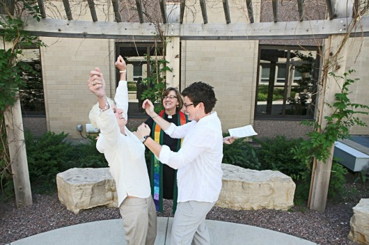 Rev. Suzelle Lynch marries Karen Wells, right, and Kristie Erickson in a ceremony outside the Waukesha County Courthouse on June 9 in Waukesha, Wis. Credit: Courtesy of MCT