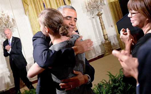 President Barack Obama comforts rape victim Lilly Jay during the launch of the 'It's On Us' campaign at the White House in Washington, D.C., on Sept. 19. Credit: Courtesy of MCT