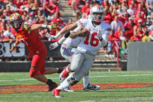 Redshirt-freshman quarterback J.T. Barrett (16) carries the ball during a game against maryland on Oct. 4 at Byrd Stadium in College Park, Md. OSU won, 52-24. Credit: Mark Batke / Photo editor