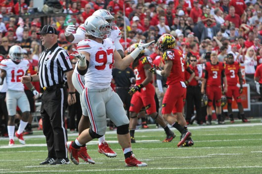 Former OSU defensive lineman Joey Bosa (97) celebrates after making a sack during a game against Maryland on Oct. 4 in College Park, Md. Credit: Lantern file photo