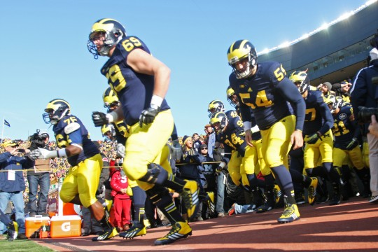 The Michigan Wolverines football team takes the field for a game against OSU on Nov. 30 at Michigan Stadium. OSU won, 42-41. Credit: Lantern file photo