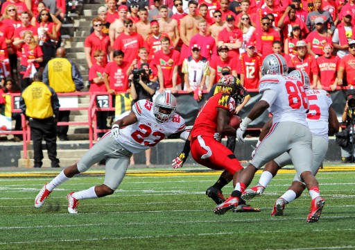 Redshirt-sophomore safety Tyvis Powell (23) dives for a tackle during a game against Maryland on Oct. 4 in College Park, Md. OSU won, 52-24. Credit: Mark Batke / Photo editor