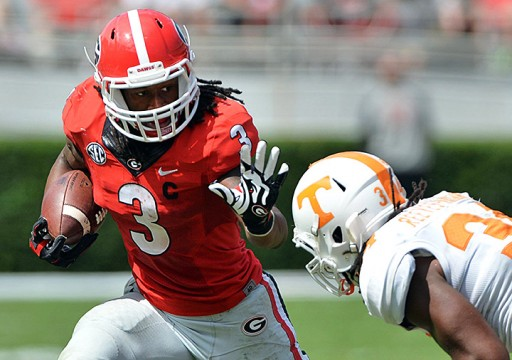 Georgia junior running back Todd Gurley (3) stiffarms a defender during a game against Tennessee at Sanford Stadium on Sept. 27. Georgia won, 35-32.  Credit: Courtesy of MCT