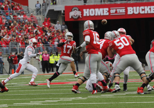 Redshirt-freshman H-back Jalin Marshall (17) reaches for a pass from redshirt-freshman quarterback J.T. Barrett (16) during OSU's 56-17 win against Rutgers on Oct. 18 at Ohio Stadium. Credit: Jon McAllister / Asst. photo editor