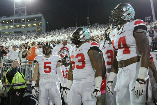 Senior tight end Jeff Heuerman (5), senior defensive lineman Michael Bennett (63) and senior linebacker Curtis Grant (14) emerge from the locker room for a game against Penn State  on Oct. 25 in State College, Pa. OSU won, 31-24, in double overtime.  Credit: Mark Batke / Photo editor