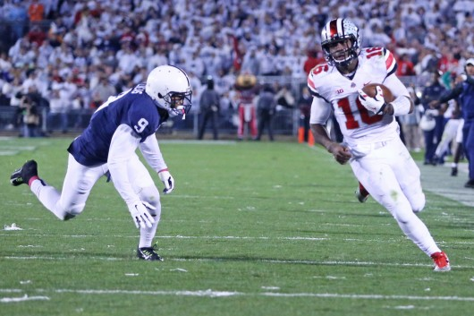 Redshirt-freshman quarterback J.T. Barrett sprained his MCL in the first half of an Oct. 25 game against Penn State, but stayed in to lead the Buckeyes to a 31-24 double-overtime win. Credit: Mark Batke / Photo editor