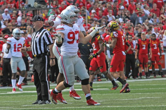 Sophomore defensive lineman Joey Bosa celebrates during a game against Maryland on Oct. 4 in College Park, Md. OSU won, 52-24. Credit: Mark Batke / Photo editor