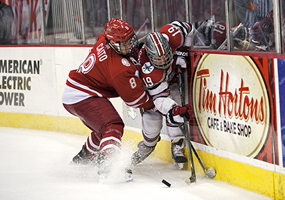 Senior forward Chad Niddery (19) is pinned to the boards during a game against Miami (Ohio) on Oct. 17 at the Schottenstein Center. OSU lost, 5-1, before falling again, 2-1, in Oxford, Ohio, on Oct. 18. Credit: Michael Griggs / For The Lantern