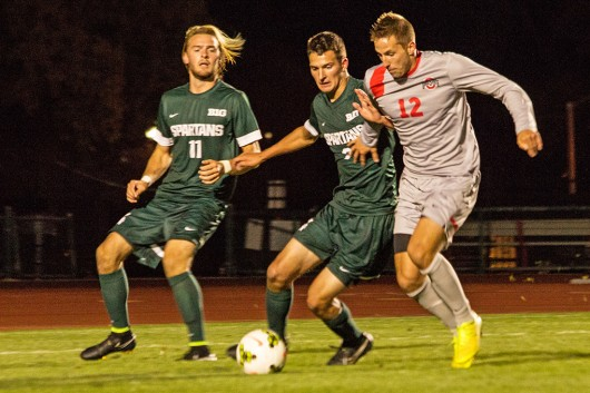 Sophomore defender Tyler Kidwell (12) fights for the ball during a game against Michigan State on Oct. 4 at Jesse Owens Memorial Stadium. OSU won, 3-2. Credit: Ed Momot / For The Lantern