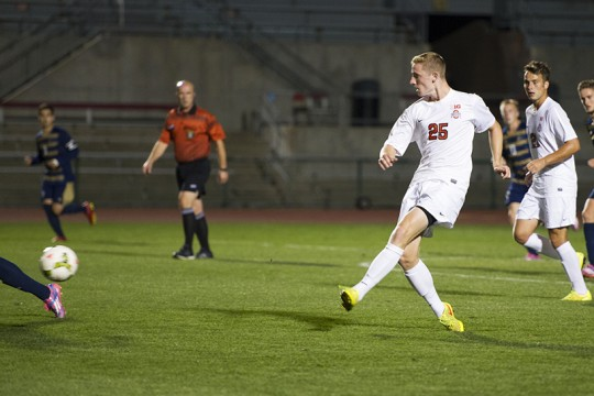 OSU sophomore defender Austin Bergstrom pushes the ball up the pitch during a game against Akron Sept. 24 at Jesse Owens Memorial Stadium. OSU lost 3-1. Credit: Ben Jackson / For The Lantern