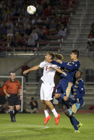 Senior midfielder Yianni Sarris heads the ball during a game against Akron on Sept. 24 at Jesse Owens Memorial Stadium. OSU lost, 3-1.  Credit: Ben Jackson / For The Lantern
