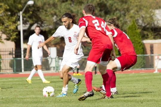 Senior midfielder Yianni Sarris (6) dribbles the ball during a game against Indiana on Oct. 12 at Jesse Owens Memorial Stadium. OSU lost, 2-1. Credit: Ed Momot / For The Lantern