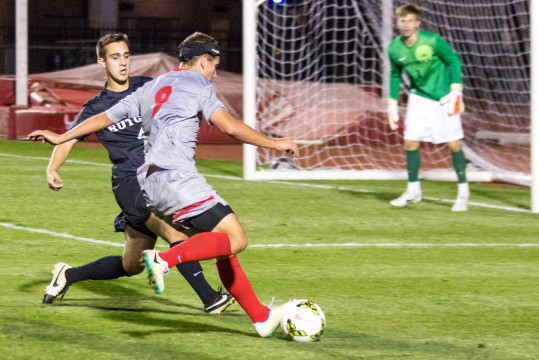Sophomore forward Danny Jensen (9) dibbles the ball during a game against Rutgers on Oct. 25 at Jesse Owens Memorial Stadium. OSU won, 4-1. Credit: Ed Momot / For The Lantern
