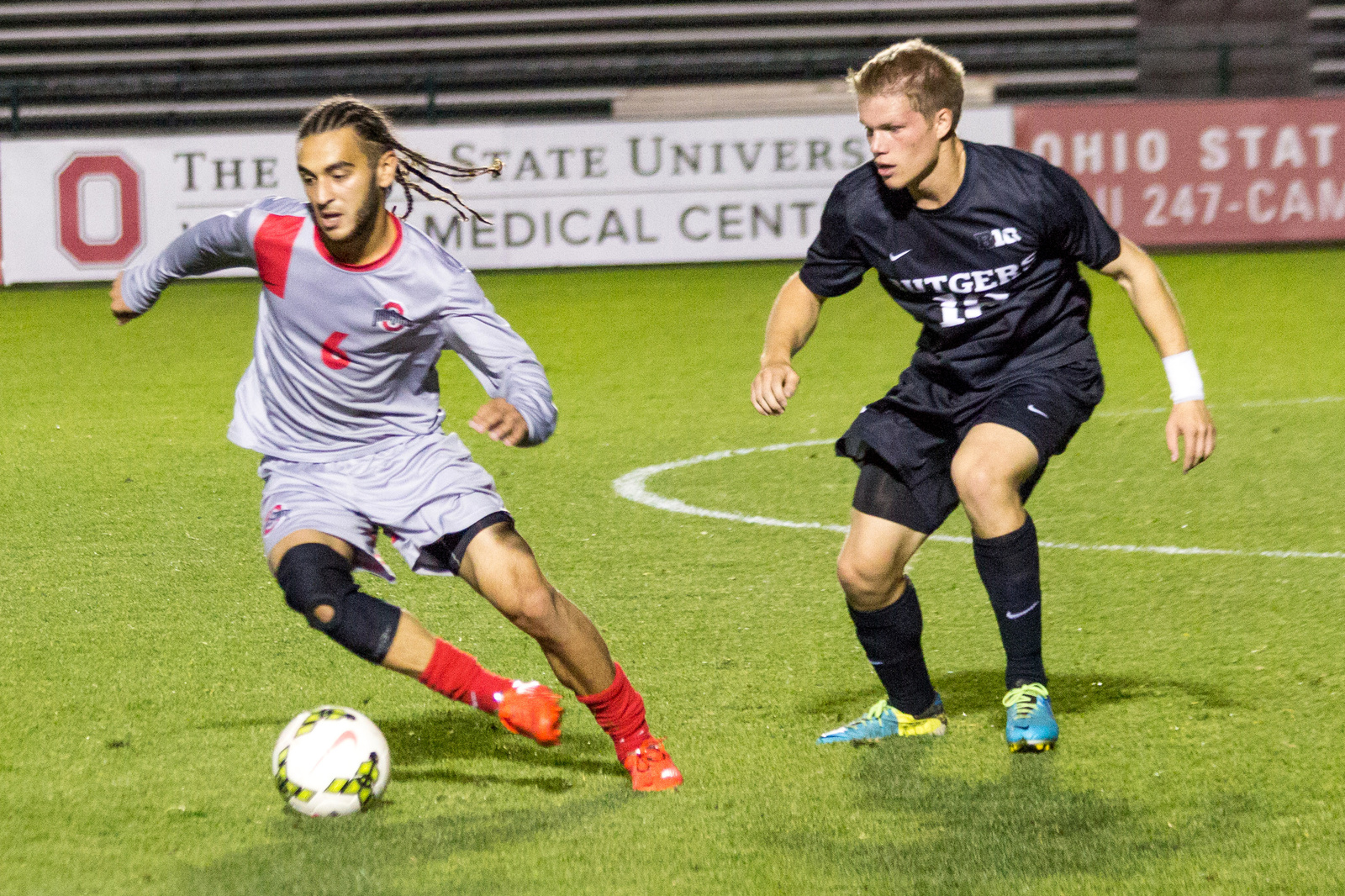 Senior midfielder Yianni Sarris avoids defenders during a game against Rutgers Oct. 25 at Jesse Owens Memorial Stadium. OSU won, 4-1. Credit: Ed Momot / For The Lantern