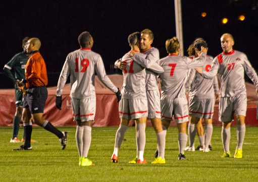 Members of the OSU men's soccer team celebrate during its 3-2 win against Michigan State on Oct. 4 at Jesse Owens Memorial Stadium. Credit: Ed Momot / For The Lantern