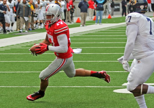 OSU redshirt-freshman H-back Jalin Marshall (17) carries the ball during a game against Kent State on Sept. 13 at Ohio Stadium. OSU won, 66-0, thanks in part to Marsahll scoring his first touchdown as a member of the Buckeyes. Credit: Mark Batke / Photo editor