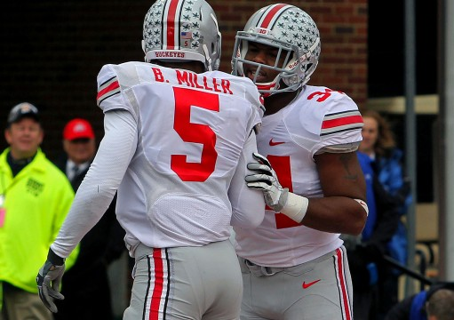 OSU then-junior quarterback Braxton Miller (5) celebrates with then-senior running back Carlos Hyde (34) during a game against Illinois Nov. 16. at Memorial Stadium in Champaign, Ill. OSU won 60-35 Credit: Lantern file photo