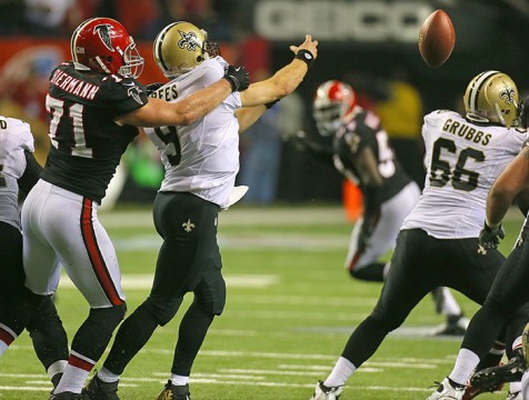 Atlanta Falcons defensive end Kroy Biermann forces New Orleans Saints quarterback Drew Brees into throwing one of five interceptions on the night at the Georgia Dome in Atlanta, Georgia, on Thursday, November 29, 2012. Atlanta topped the Saints, 23-13.  Credit: Courtesy of TNS