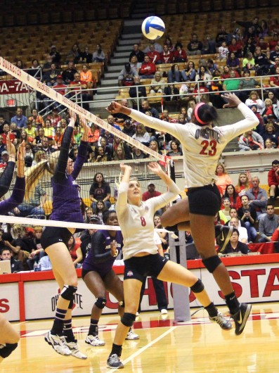 Junior middle blocker Tyler Richardson (23) jumps up to spike the ball in a game against Northwestern on Oct. 11 at St. John Arena. OSU won, 3-1. Credit: Abigail Hofrichter / Lantern photographer