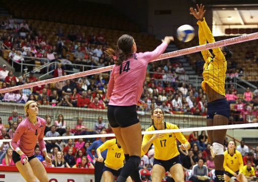 Junior outside hitter Elizabeth Campbell (14) spikes the ball during a match against Michigan on Oct. 25 at St. John Arena. OSU won, 3-0. Credit: Muyao Shen / Lantern photographer