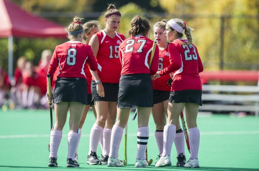 OSU field hockey players gather in a huddle during a game against Iowa on Oct. 19, 2014 at Buckeye Varsity Field. OSU lost, 4-2.  Credit: Lantern file photo