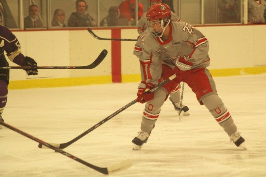 Then-sophomore forward Katie Matheny skates down the ice during a game against New Hampshire on Oct. 4, 2014 at the Ohio State Ice Rink. OSU won, 4-3. Credit: Lantern file photo