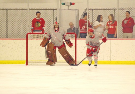 OSU freshman goaltender Kassidy Sauve watches as sophomore defenseman Alexa Ranahan pushes the puck up the ice in a game against New Hampshire Oct. 4. OSU won 4-3. Credit: Melissa Prax / Lantern photographer