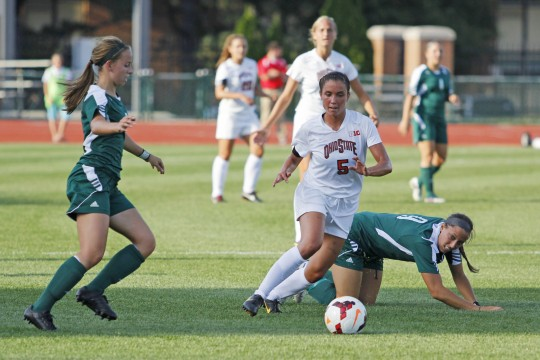 Then junior midfielder/forward Ellyn Gruber (5) pushes the ball up the field during a game against Eastern Michigan Aug. 25, 2013. OSU won 2-1 in OT. Credit: Lantern file photo