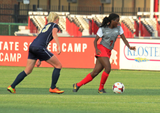 Then-freshman Nichelle Prince (7) avoids a defender during a game against Pittsburgh Aug. 28, 2013. OSU won 2-0.  Credit: Lantern file photo