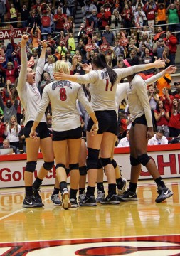 Members of the OSU women's volleyball team celebrate during a match against Northwestern on Oct. 11 at St. John Arena. OSU won, 3-1. Credit: Abigail Hofrichter / Lantern photographer