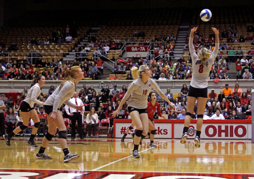 Senior Taylor Sherwin (8) backsets to sophomore Taylor Sandbothe (10) in the match against Northwestern on Saturday Oct.11 at St. Johns Arena. OSU won 3-1. Credit: Abby Hofrichter / For The Lantern