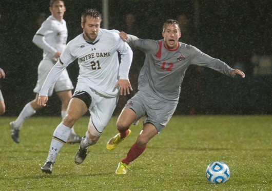 OSU then-sophomore defender Tyler Kidwell (12) battles for possession of the ball with Notre Dame senior forward Vince Cicciarelli (21) during a Nov. 23 game in South Bend, Ind. OSU lost, 2-1. Credit: Kevin Sabitus / The Observer