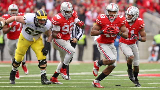 Redshirt-freshman linebacker Darron Lee (43) runs a recovered fumble toward the end zone during a game against Michigan on Nov. 29 at Ohio Stadium. OSU won, 42-28. Credit: Mark Batke / Photo editor