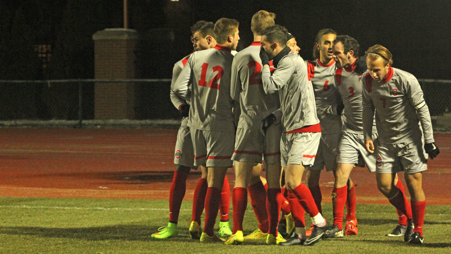 Members of the OSU men's soccer team celebrate a goal from junior defender Kyle Culbertson (3) during a match against Akron on Nov. 20 at Jesse Owens Memorial Stadium. OSU advanced on penalty kicks, 1-1 (13-12).  Credit: Emily Yarcusko / For The Lantern