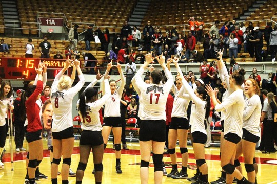 Members of the OSU women's volleyball team celebrate a win against University of Maryland on Nov. 7 at St. John Arena. OSU won 3-1. Credit: Madelyn Grant / Lantern photographer