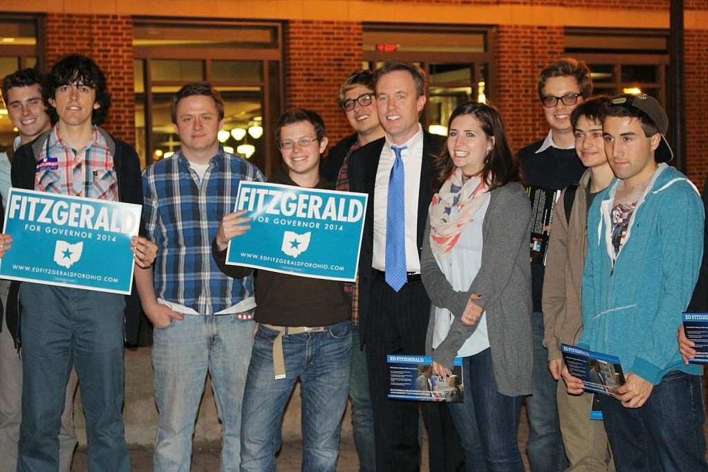 Gubernatorial candidate Ed FitzGerald (in blue tie) poses with supporters on Nov. 4 at the Ohio Union. Credit: Molly Tavoletti / Lantern photographer