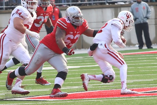 OSU senior defensive lineman Michael Bennett (63) attempts to tackle Indiana freshman quarterback Zander Diamont during a game on Nov. 22 at Ohio Stadium. OSU won, 42-27.  Credit: Mark Batke / Photo editor
