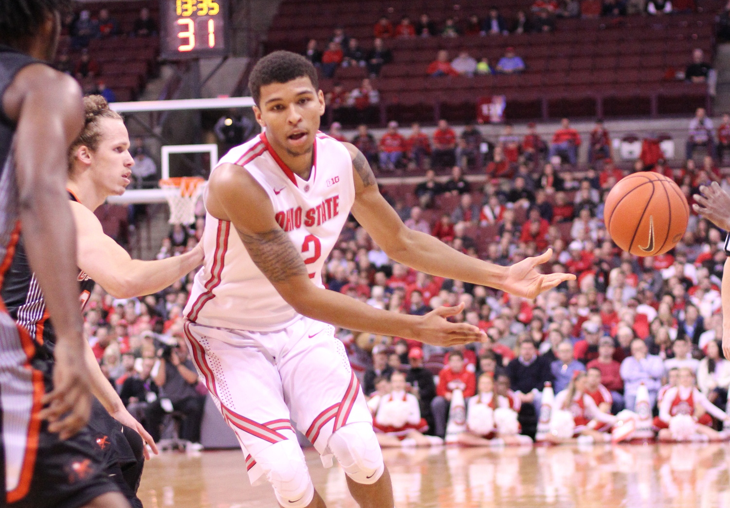 Sophomore forward Marc Loving (2) passes the ball during a game against Campbell on Nov. 26 at the Schottenstein Center. OSU won, 91-64. Credit: Ed Momot / For The Lantern
