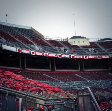 The eight names and numbers hanging up at Ohio Stadium honoring five Heisman Trophy winners and two OSU greats. Credit: Hayden Grove