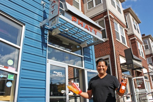 Phatt Wraps owner Jose Becerra poses outside of his store, located at 10 E. 12th Ave., on Oct. 29.  Credit: Chahinaz Seghiri / Lantern photographer