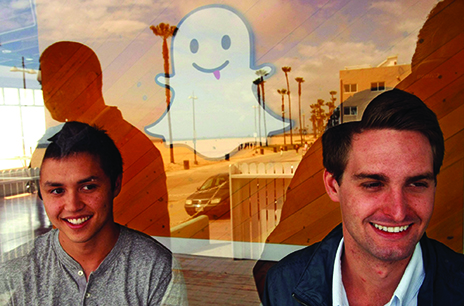 Snapchat co-creators Bobby Murphy (left) and Evan Spiegel are seen through a window at the company's offices in May 2013 in Venice, Calif. Credit: Courtesy of TNS