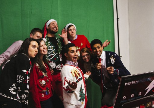 Patrons of Christmisc. use the photo booth in the seasonal pop-up store located in the South Campus  Gateway. Credit: Courtesy of Nate DeMars.