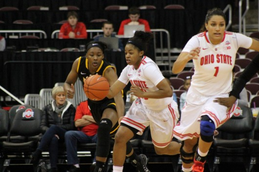 OSU freshman guard Asia Doss and redshirt sophomore forward Kalpana Beach make their way to the Buckeyes' side of the court during the first half of the OSU Women's Basketball game against VCU on November 23, 2014. OSU went on to win 96-86. Credit: Lantern file photo