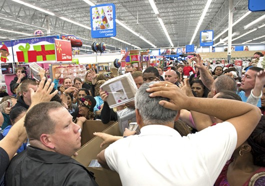 Shoppers who didn't wait until midnight jostle and grab for cotton sheets as employees unpack the sale items after converging at a Walmart store shortly before 8 p.m. on Nov. 22, 2012, to get a head start on Christmas shopping. Credit: Courtesy of TNS