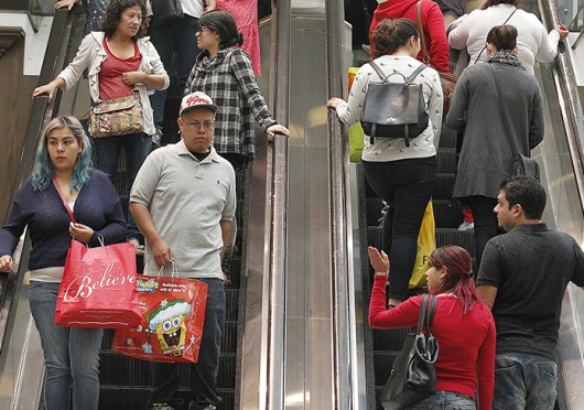 Black Friday shoppers at the Glendale Galleria crowd the escalators in Glendale, Calif., on Nov. 28. Credit: Courtesy of TNS