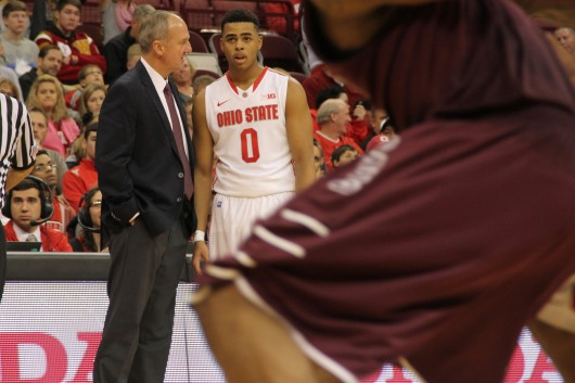 OSU coach Thad Matta talks with freshman guard D'Angelo Russell (0) during an exhibition game against Walsh on Nov. 9 at the Schottenstein Center. OSU won, 77-37. Credit: Patrick Kalista / Lantern photographer