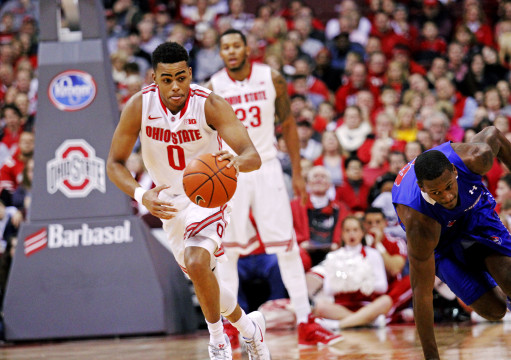 OSU freshman guard D'Angelo Russell (0) dribbles past a UMass-Lowell player during a Nov. 14 game at the Schottenstein Center. OSU won, 92-55. Credit: Chelsea Spears / Multimedia editor