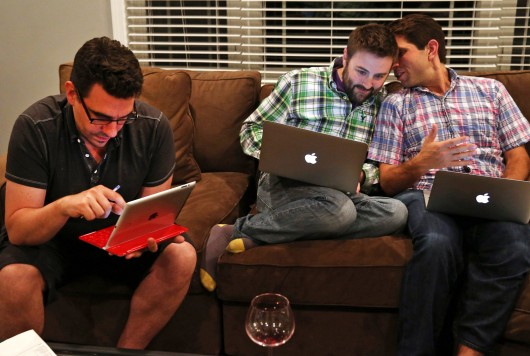 From left, Frank Baiocchi, Murphy Monroe and Jonathan Hoenig gather during their fantasy football draft picks at the home of one of their friends, in Deerfield, Ill., on Sept. 1, 2013. Credit: Courtesy of TNS
