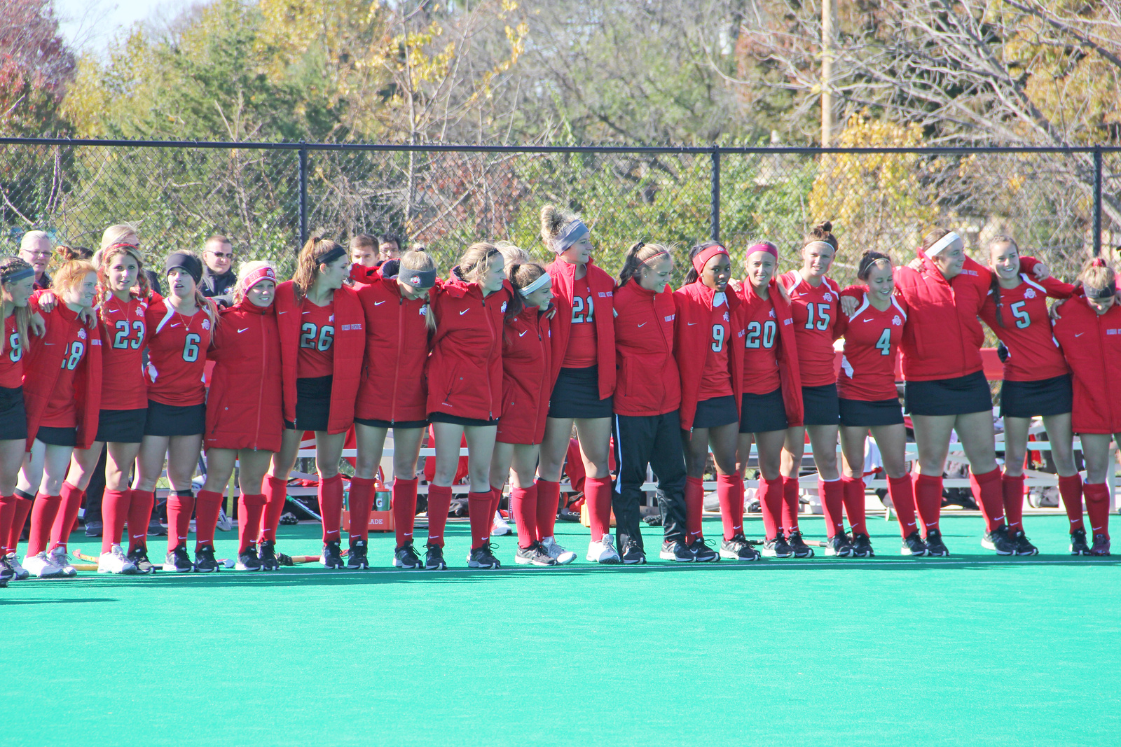 Members of the Ohio State field hockey team sing 'Carmen Ohio' after a 2-1 loss to Michigan on Nov. 2 at Buckeye Varsity Field. Credit: Grant Miller / Copy chief